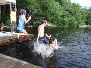 Kids jumping in water - A Parents' Guide to Extended School Year Services: Summer Break a Teaching and Learning Opportunity