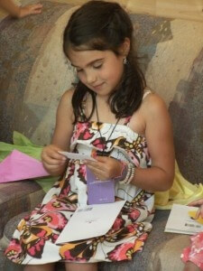 Child opening gifts: Reduce Celebration Anxiety: How to Give and Receive Gifts