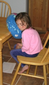 Tired child sleeping at the table - What Is Being Said About Melatonin As a Sleep Aid for Children and Teens