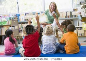 -students-in-class-volunteering-for-teacher-77123365