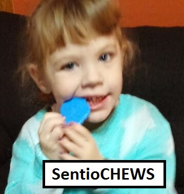 Child with chew necklace: KidCompanions Chewelry & SentioCHEWS: SAFE, Sensory Chew Necklaces and Clip-on Fidgets