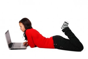 teen girl with computer for homework schedule