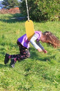 Child swinging - Helping Kids with ADHD: Top Ten Ways on How to Increase Concentration Skills