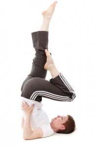 Person in yoga pose - Sitting on huge balls and keeping your balance, crab walks/crawls, yoga