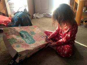 Child decoring a gift bab. Best Gifts For Children with Special Needs by Marcela De Vivo
