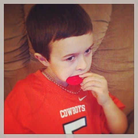 Child with a SentioCHEWS chew necklace - Show, Tell and WIN Chewelry from SentioLife Solutions