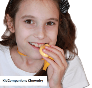 Ania chewing on KidCompanions Chewelry.KidCompanions Chewelry and SentioCHEWS are both mouth fidgets and hand fidgets.