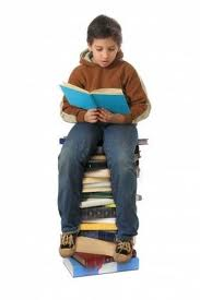 student with a pile of books - Coping with an Introverted Child by Ashley Hardway