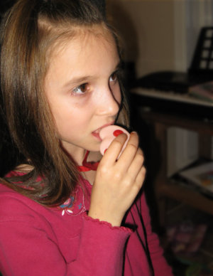Child chewing a chew pendant from the line of KidCompanions Chewelry - Sensory Tools Help a Child to Survive Sensory Overload, Calm and Focus