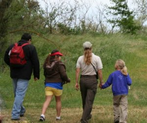 Family walking - Tips to Help a Child with Autism Enjoy a Break in Routine