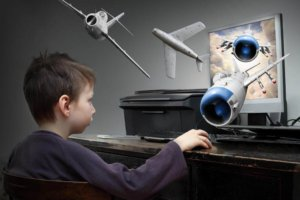 Boy gaming - How Technology is Increasingly Putting Our Children into Dangerous Positions